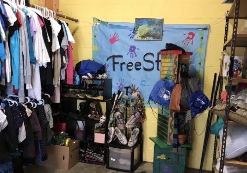 Clothes and other items hanging up in UNC Asheville's FreeStore